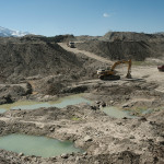 Gold mining in the Andean Piedmont leaves artificial pits and ponds.